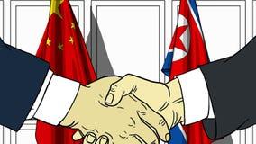 Zakenlieden of politicischokhanden tegen vlaggen van China en Noord-Korea Officiële verwante vergadering of samenwerking royalty-vrije illustratie