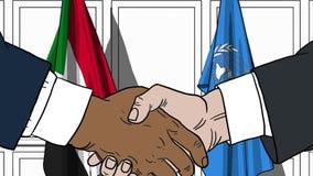 Zakenlieden of politicischokhanden tegen vlaggen van de Soedan en de Verenigde Naties Offici?le vergadering of samenwerking vector illustratie