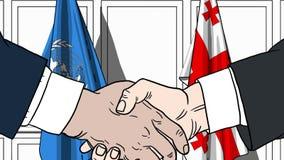 Zakenlieden of politicischokhanden tegen vlaggen van de Verenigde Naties en Georgi? Offici?le vergadering of samenwerking stock illustratie