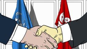 Zakenlieden of politicischokhanden tegen vlaggen van de Verenigde Naties en Hong Kong Officiële vergadering of samenwerking vector illustratie
