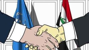 Zakenlieden of politicischokhanden tegen vlaggen van de Verenigde Naties en Irak Offici?le verwante vergadering of samenwerking royalty-vrije illustratie