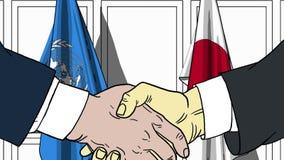 Zakenlieden of politicischokhanden tegen vlaggen van de Verenigde Naties en Japan Officiële vergadering of samenwerking stock illustratie