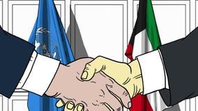 Zakenlieden of politicischokhanden tegen vlaggen van de Verenigde Naties en Koeweit Offici?le vergadering of samenwerking royalty-vrije illustratie