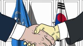 Zakenlieden of politicischokhanden tegen vlaggen van de Verenigde Naties en Korea Officiële vergadering of samenwerking royalty-vrije illustratie