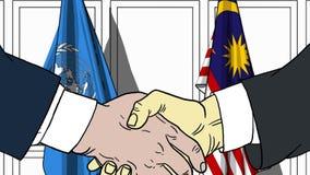 Zakenlieden of politicischokhanden tegen vlaggen van de Verenigde Naties en Maleisië Officiële vergadering of samenwerking vector illustratie