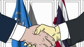 Zakenlieden of politicischokhanden tegen vlaggen van de Verenigde Naties en Thailand Officiële vergadering of samenwerking vector illustratie