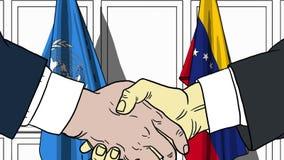 Zakenlieden of politicischokhanden tegen vlaggen van de Verenigde Naties en Venezuela Offici?le vergadering of samenwerking stock illustratie