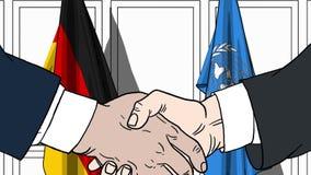 Zakenlieden of politicischokhanden tegen vlaggen van Duitsland en de Verenigde Naties Officiële vergadering of samenwerking vector illustratie