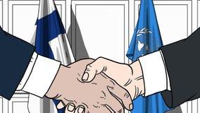 Zakenlieden of politicischokhanden tegen vlaggen van Finland en de Verenigde Naties Offici?le vergadering of samenwerking stock illustratie