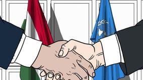 Zakenlieden of politicischokhanden tegen vlaggen van Hongarije en de Verenigde Naties Offici?le vergadering of samenwerking stock illustratie