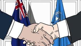 Zakenlieden of politicischokhanden tegen vlaggen van Nieuw Zeeland en de Verenigde Naties Offici?le vergadering of samenwerking royalty-vrije illustratie