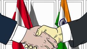 Zakenlieden of politicischokhanden tegen vlaggen van Oostenrijk en India Officiële verwante vergadering of samenwerking royalty-vrije illustratie