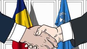 Zakenlieden of politicischokhanden tegen vlaggen van Roemeni? en de Verenigde Naties Offici?le vergadering of samenwerking royalty-vrije illustratie