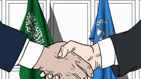 Zakenlieden of politicischokhanden tegen vlaggen van Saudi-Arabië en de Verenigde Naties Officiële vergadering of samenwerking vector illustratie