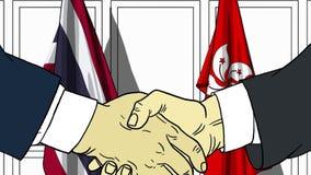 Zakenlieden of politicischokhanden tegen vlaggen van Thailand en Hong Kong Officiële verwante vergadering of samenwerking royalty-vrije illustratie