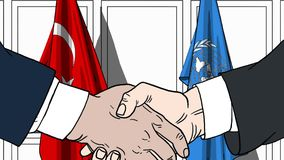 Zakenlieden of politicischokhanden tegen vlaggen van Turkije en de Verenigde Naties Officiële vergadering of samenwerking vector illustratie