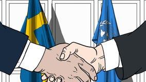 Zakenlieden of politicischokhanden tegen vlaggen van Zweden en de Verenigde Naties Officiële vergadering of samenwerking stock illustratie