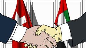 Zakenlieden of politicischokhanden tegen vlaggen van Zwitserland en de V.A.E Officiële verwante vergadering of samenwerking royalty-vrije illustratie