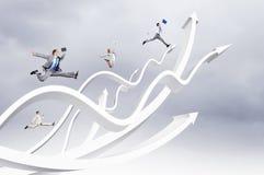 Zakenlui het springen Stock Foto