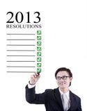Zakenman 2013 resoluties die in wit worden geïsoleerds Stock Foto
