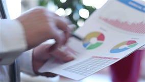 Zakenman Analyzing Income Graphs stock video