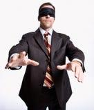 Zakenman in blinddoek Stock Afbeelding