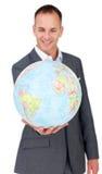 Zakenman die bij globale bedrijfsuitbreiding glimlacht Stock Afbeelding