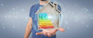 Zakenman die 3D het teruggeven grafiek van de energieclassificatie in houten h gebruiken Stock Afbeelding