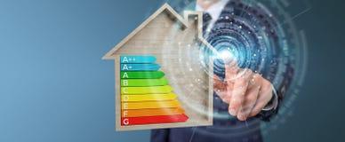 Zakenman die 3D het teruggeven grafiek van de energieclassificatie in houten h gebruiken Stock Foto