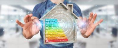 Zakenman die 3D het teruggeven grafiek van de energieclassificatie in houten h gebruiken Royalty-vrije Stock Afbeeldingen