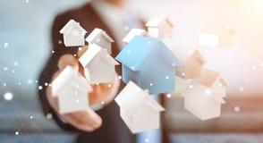 Zakenman die 3D teruggegeven kleine witte en blauwe huizen gebruiken Royalty-vrije Stock Foto's