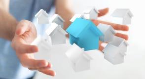 Zakenman die 3D teruggegeven kleine witte en blauwe huizen gebruiken Stock Afbeelding