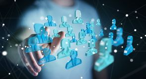 Zakenman die 3D teruggevende groep blauwe mensen houden Stock Afbeelding