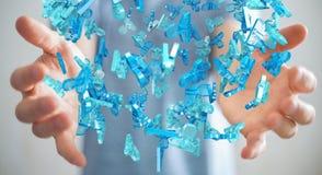 Zakenman die 3D teruggevende groep blauwe mensen houden Royalty-vrije Stock Fotografie