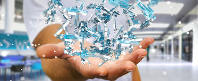 Zakenman die 3D teruggevende groep blauwe mensen houden Stock Fotografie