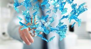 Zakenman die 3D teruggevende groep blauwe mensen houden Stock Foto's