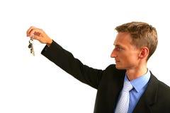 Zakenman die de sleutel houdt Stock Foto