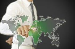 Zakenman die de wereld drukken te veranderen. Royalty-vrije Stock Foto