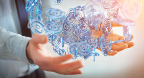 Zakenman die digitaal arobase blauw gebied gebruiken om op intern te surfen Royalty-vrije Stock Fotografie