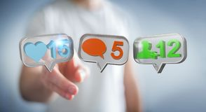 Zakenman die digitale kleurrijke sociale media pictogrammen 3D renderi gebruiken Stock Foto