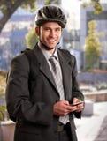 Zakenman die door fiets gaat werken Stock Fotografie