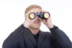 Zakenman die door verrekijkers kijkt Royalty-vrije Stock Afbeelding