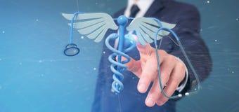 Zakenman die een 3d het redering medische cadaceus en een stethosco houden Royalty-vrije Stock Foto