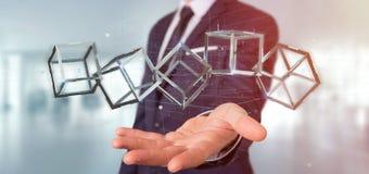 Zakenman die een 3d het teruggeven blockchain kubus houden die op a wordt geïsoleerd Stock Afbeeldingen