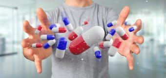 Zakenman die een 3d teruggevende groep medische pillen houden Stock Foto