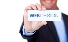 Zakenman die een etiket met Webontwerp houden die op het wordt geschreven Stock Afbeelding