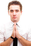 Zakenman die een gebed maakt Stock Foto