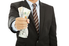 Zakenman die een handvol ons houden dollars Stock Foto
