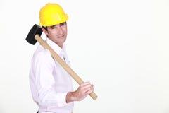 Zakenman die een helm houdt royalty-vrije stock afbeelding