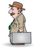 Zakenman die een koffer draagt Stock Fotografie